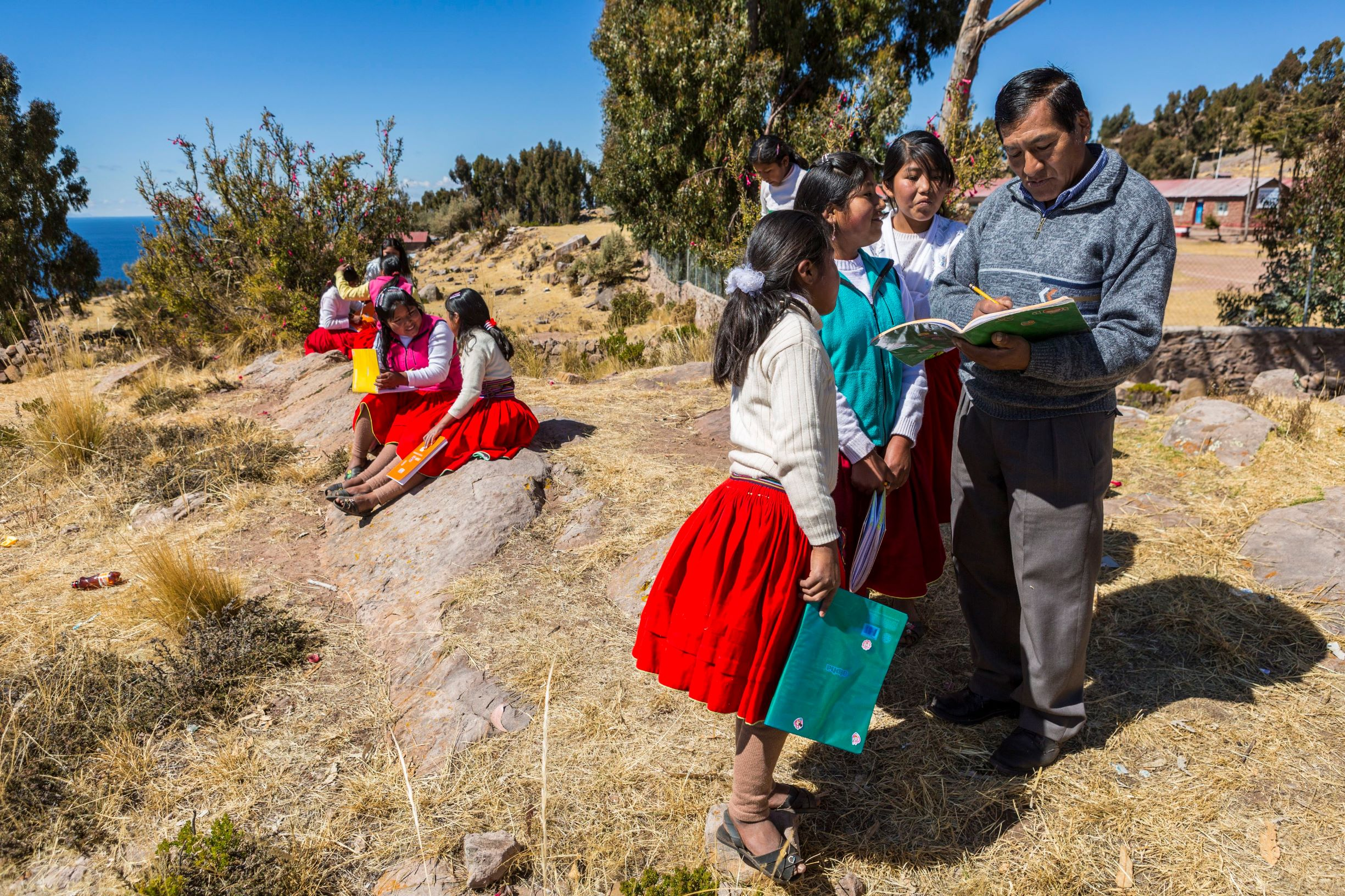 A teacher working with students in Puno province in Peru.